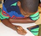 Sixth grader creating self-portrait