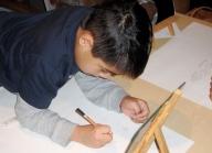 Ryan drawing his self-portrait